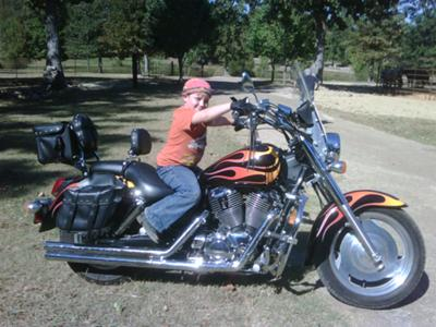 That's our youngest Grandson & Grandchild sitting on my bike.I have added more stuff onto it now. This was taken Summer of 2010.