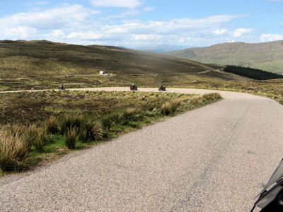 Sweeping Curve on a Country Road in the Scottish Highlands