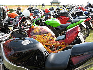 A parking lot filled to capacity with motorcycles
