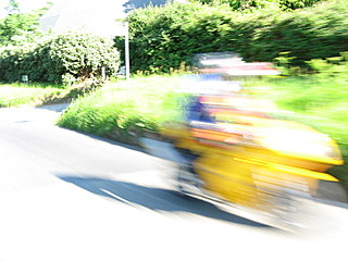 A really speedy bright yellow motorcycle passing me...probably enroute to a ticket.