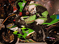 A motorcycle and the the leathers worn by the rider.