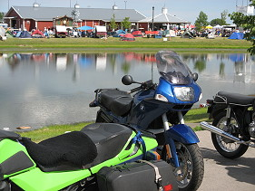 Motorcycles and camping tents at a rally.
