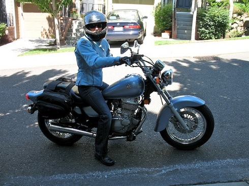 Woman On Suzuki GZ250 Motorcycle