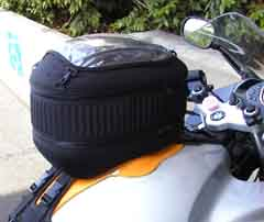 A tank bag, filled to the brim with stuff