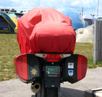 Motorcycle with bright red cover, at the BMW Rally in Wisconsin