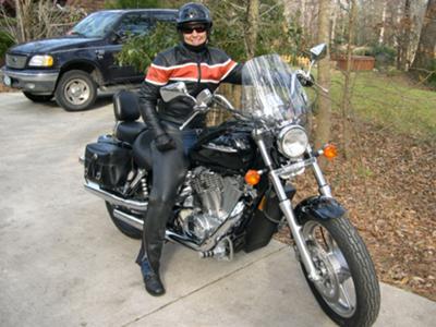 A girl on a shiny bike!