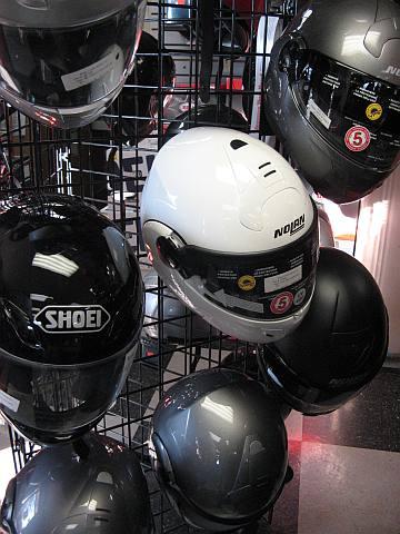 Many Motorcycle Helmets
