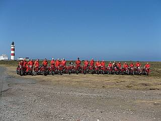 The entire Moto Guzzi group on the Isle of Man, posing with their vintage MG motorcycles.