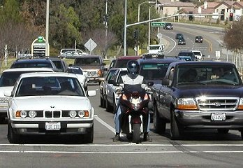 Image result for motorcycle in traffic