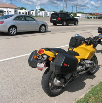 My rather uncomfortable seat, taking a break on a busy highway.