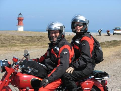 Regina and husband, on their borrowed Moto Guzzi
