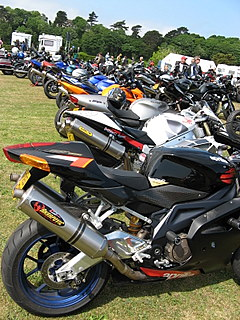 More motorcycles parked in a field.