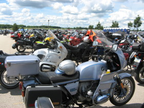 Many motorcycles parked at a motorcycle rally