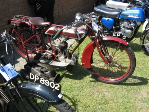 Another beautiful vintage motorcycle at a rally.