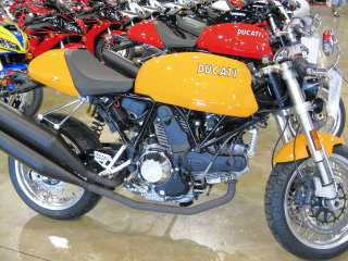 Shiny, bright new yellow Ducati, waiting for a new home.